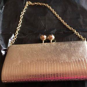 Gold Aldo hand purse
